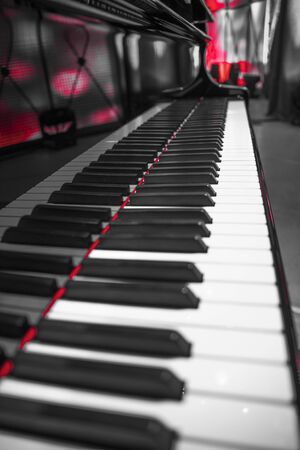 grand piano on the stage before the performance. black and white photography.