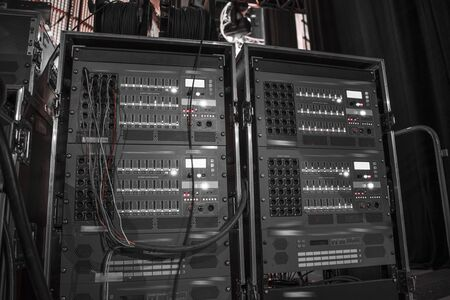 sound equipment at the concert. television shooting. black and white photography.