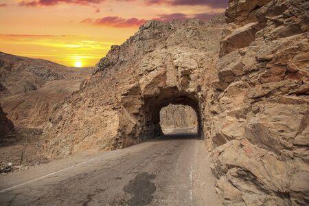 road through the rocks in the Atacama Desert. Chile. Фото со стока