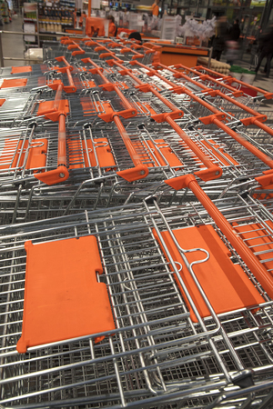 shopping carts in a store stand in a row