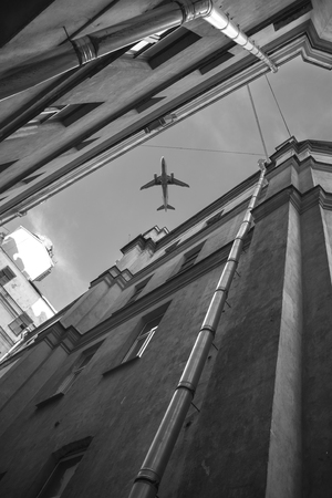 the plane flies over the houses of the city of St. Petersburg. Russia. Black and white photography 写真素材