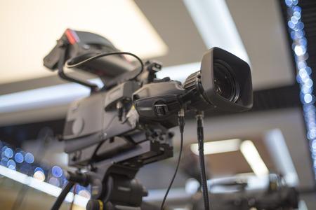 TV camera in recording and live studio Imagens