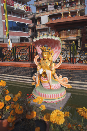 golden statue of Chenrezig stands in Kathmandu. Nepal Banco de Imagens
