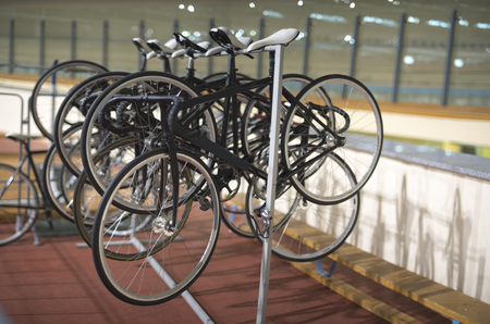 Bicycles for the cycle track are on the stand Stock Photo - 122164990