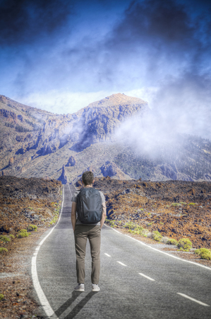 A man walks against the background of the volcano Teide. Tenerife.