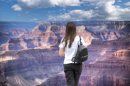 woman walks the Grand Canyon in the USA