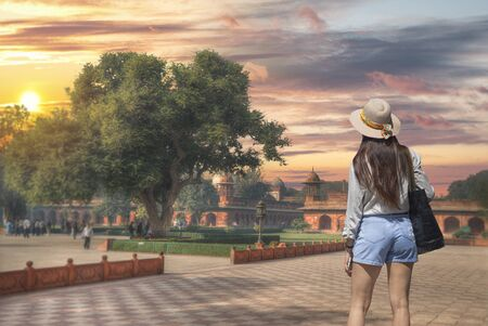 Tourist girl walks by sights in Agra Stock Photo