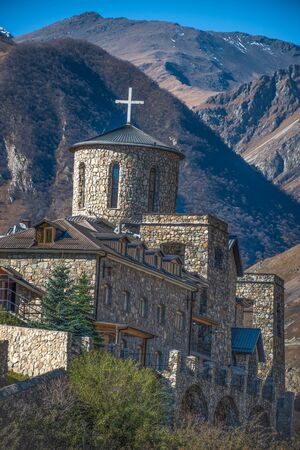 Fiagdon Monastery in North Ossetia. Mountains of the Caucasus Фото со стока