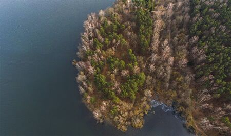 Late fall. River and forest. Shot on a drone Фото со стока