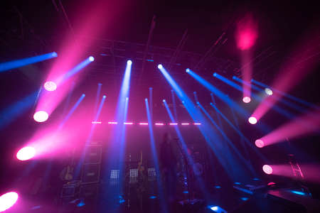 rays of light illuminate the scene at the concert.