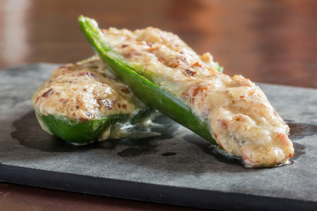 cheesy: Cheesy stuffed jalapeno peppers snack prepared ready to eat
