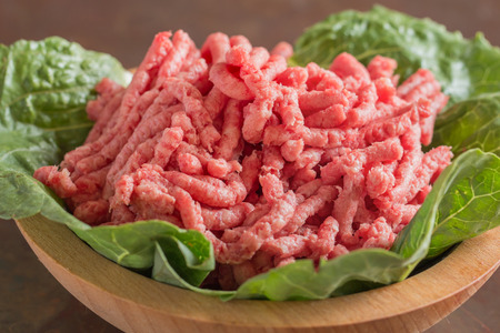 ground beef: Closeup of bowl full of raw red lean ground meat beef