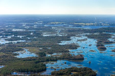 Aerial view of uninhabited rural wild natural Florida marsh wetland landscape