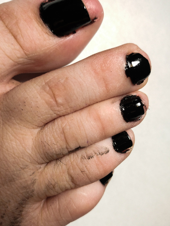 Black Manicure, Pedicure at home, missed the fingernails, mess. Isolated on white grey gray background, closeup, selective focus.