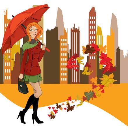 autumn scene: women with umbrella in the city