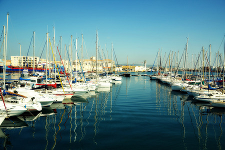 docker: Port Of Sete in France. Colorful Boats in the harbor of of Sete, captured during winter. Sete - fascinating small town on the French Mediterranean coast known as the Venice of Languedoc.