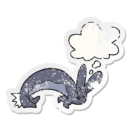 funny cartoon rabbit with thought bubble as a distressed worn sticker