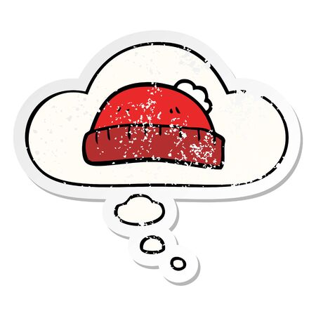 cartoon woolly hat with thought bubble as a distressed worn sticker Stock fotó - 129815763