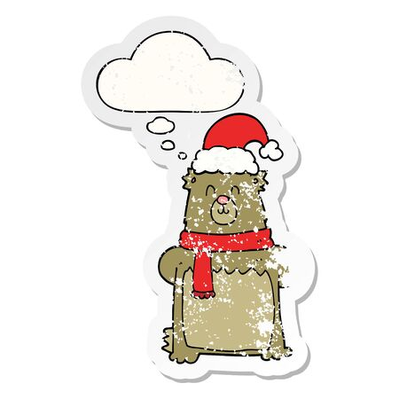 cartoon bear wearing christmas hat with thought bubble as a distressed worn sticker  イラスト・ベクター素材