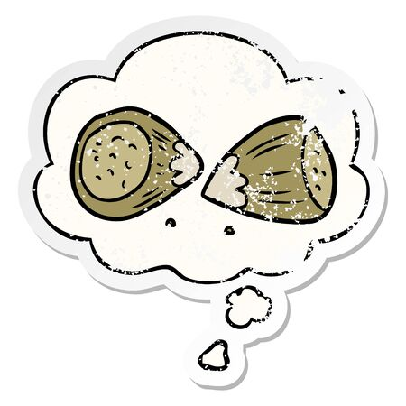cartoon hazelnuts with thought bubble as a distressed worn sticker Stock Illustratie