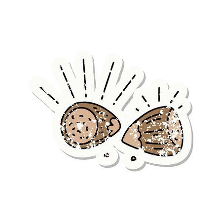 worn old sticker of a tattoo style hazelnuts