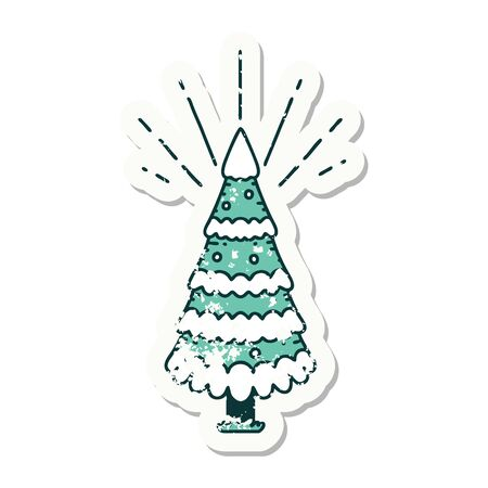 worn old sticker of a tattoo style snow covered pine tree