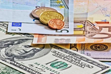 dumping: euro dollars and czech money coins closeup