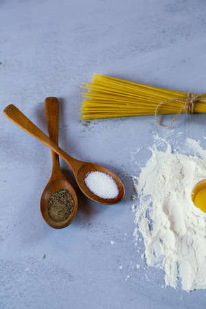 ingredients for homemade pasta. Food background: macaroni, spagetti, egg, flour