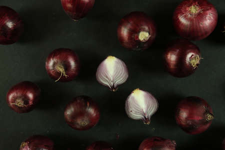 sweet red onions on background