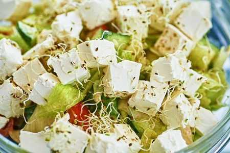 Cress salad with cheese in a glass bowl Stock Photo