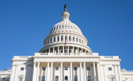 Looking up at the back of The Capitol Building in Washington, D.C. with a bright blue sky. Editorial