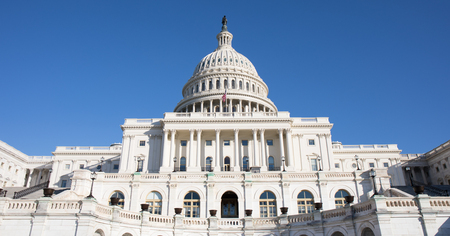 Looking up at the back of The Capitol Building in Washington, D.C. with a bright blue sky. Stock Photo