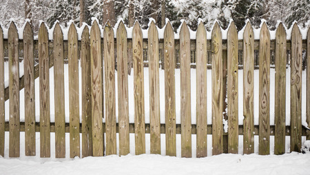 A picket fence covered with snow and the snow is still coming down. Reklamní fotografie