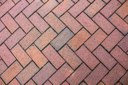A brick angled sidewalk for a patterned background.