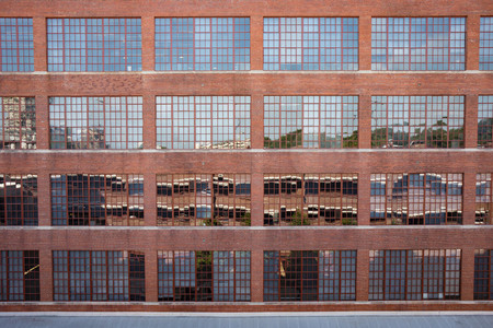 Exterior photo of large warehouse windows. Archivio Fotografico
