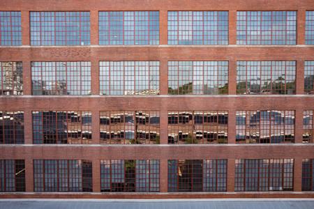Exterior photo of large warehouse windows. Фото со стока