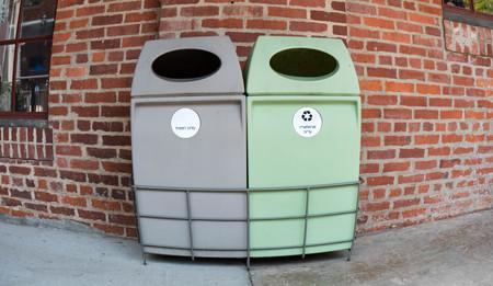 A trash bin and recycling bin with a fish eye special affect. Фото со стока