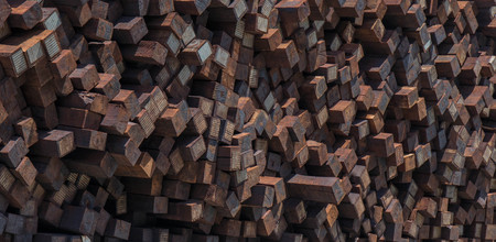 Close up photo of a stack of discarded and unused railroad ties.