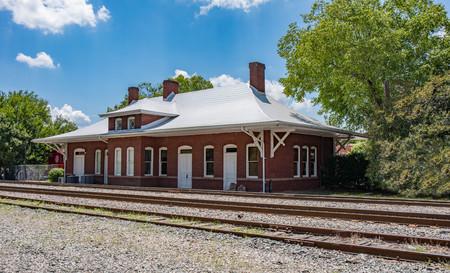 An old historical railroad station in Apex, North Carolina.  (high saturation) Archivio Fotografico