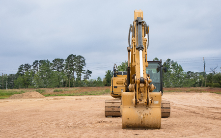 An excavator sitting at a construction site. Archivio Fotografico