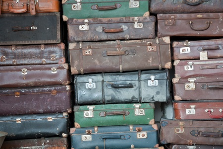 Pile of  colorful vintage suitcases. photo