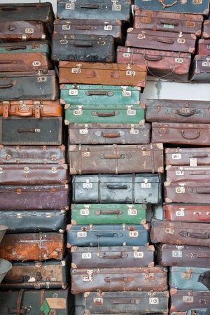 Pile of  colorful vintage suitcases. Stock Photo
