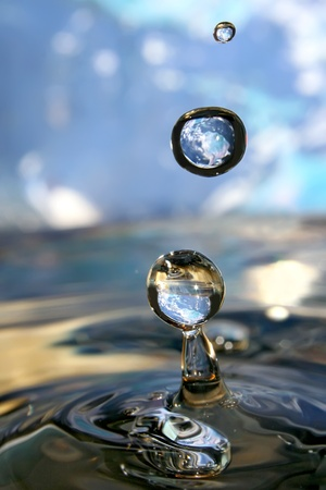 Earth in drop of water. Stock Photo - 12026750
