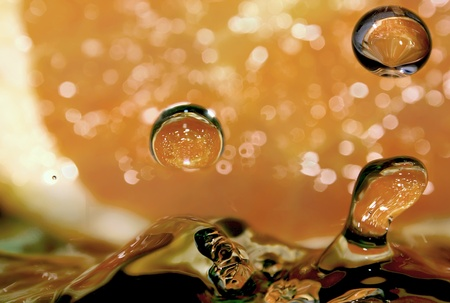 Here are the pure drops of water, the rest is the play with background and light. The background is a fresh orange.