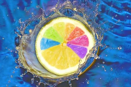 exotic gleam: Splash with fresh lemon. Pure water. Blue background. Stock Photo
