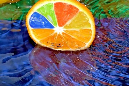 exotic gleam: Splash with fresh citrus. Pure water. Blue background. Stock Photo