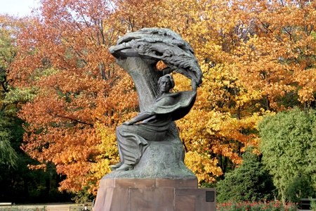 Fall park with monument of Frederick Chopin - Warsaw, Poland.
