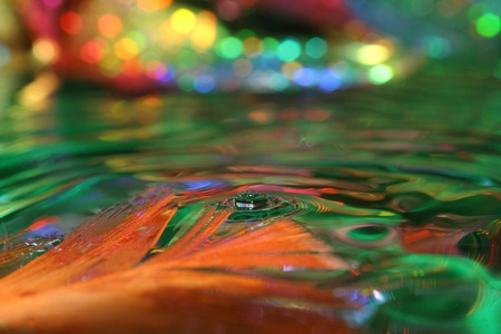 Optimistic rain. Colored drops of water. photo