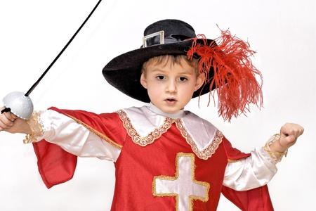 Jongen met carnaval kostuum Little gevechten musketier
