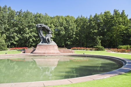 Summer park with monument of Chopin - Warsaw, Poland  photo